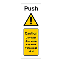 Push Caution only open door when sheltered from strong wind (Marine Sign)
