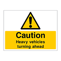 Caution Heavy vehicles turning ahead sign