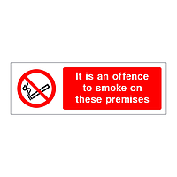 It is an offence to smoke on these premises sign