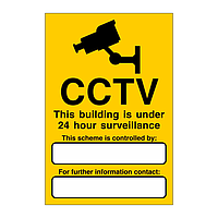 CCTV This building is under 24 hour surveillance sign