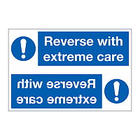 Reverse with extreme care sign